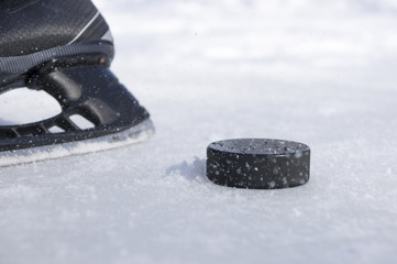 hockey skate and puck