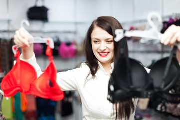 ordinary girl choosing bra at fashion shop