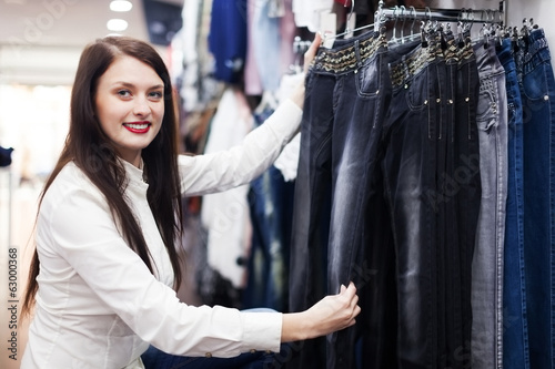Girl choosing trousers