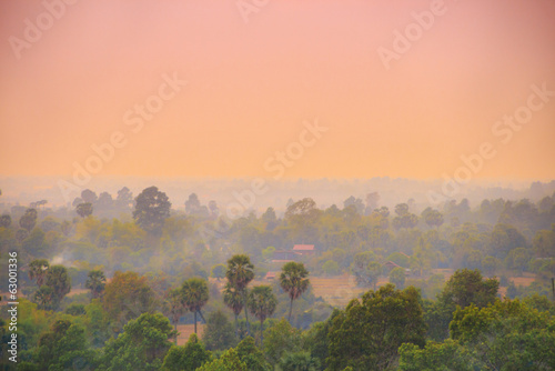 Sunset over asian town and jungle