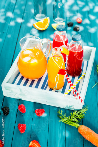 Bottles of fresh squeezed citrus and berry juice