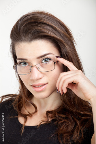 close up of beautiful young woman with eyeglasses
