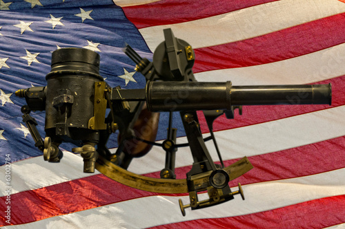 Old Antique Sextant on american flag background