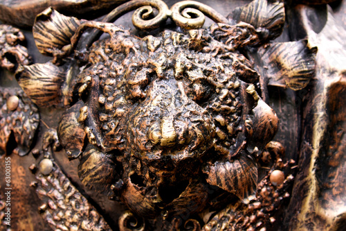 Forged head of a lion