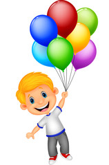 Young boy flying with balloon