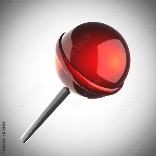 Red lollipop on gray background