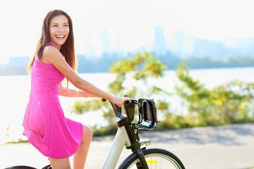 Woman on bike biking in city park