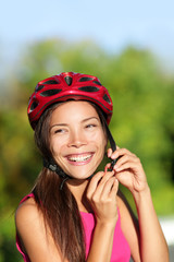 Biking helmet - woman putting bicycle helmet