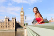 London - happy woman by Big Ben in England