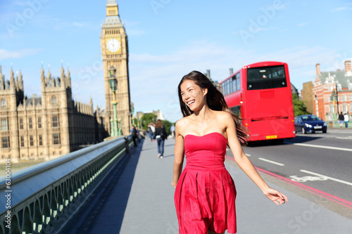 London woman happy walking by Big Ben, England