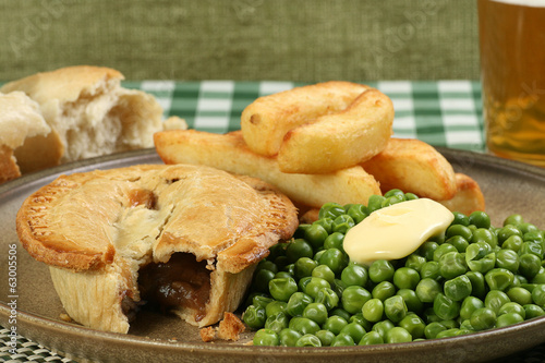 steak pie with fries and peas