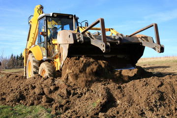 Bulldozer, excavator pushes the ground