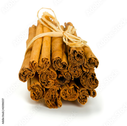 ceylon cinnamon sticks tied up on white background