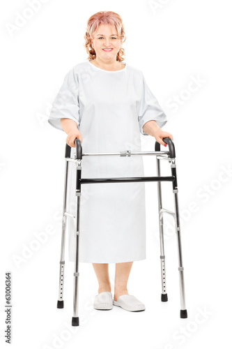 Female patient walking with walker