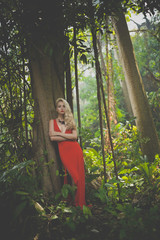 Beautiful lady in tropical forest