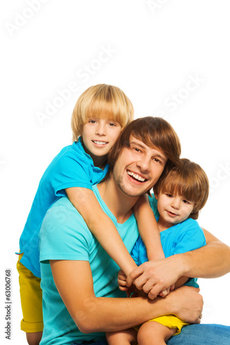 Dad with two little sons