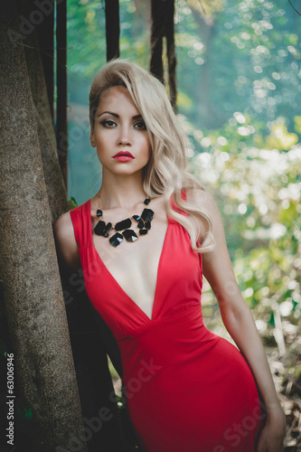 Beautiful lady in tropical forest - 63006946