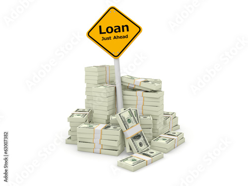 Loan road sign with stacks of dollars