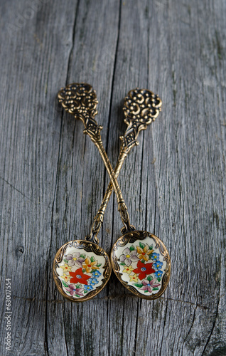 Vintage teaspoons on a on wooden table