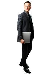 Full-length portrait of a businessman standing