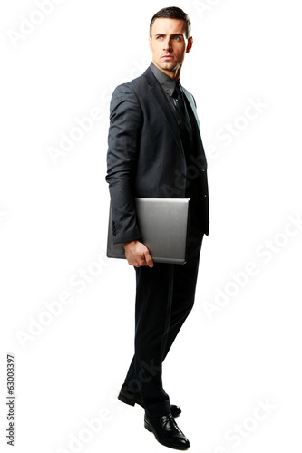 Full-length portrait of a businessman standing