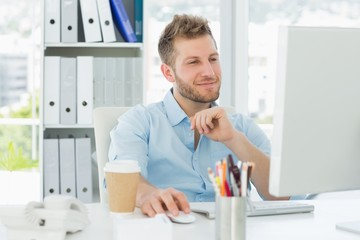 Smiling man working at his desk