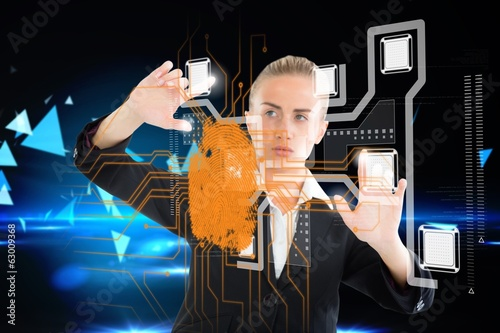 Blonde businesswoman touching interface with fingerprint