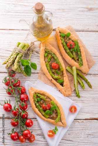 home-baked pide with green asparagi