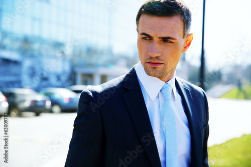 Portrait of a pensive businessman on the street