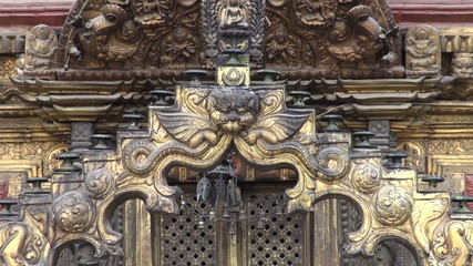 ornate  buddhist temple door in Katmandu old town, Nepal