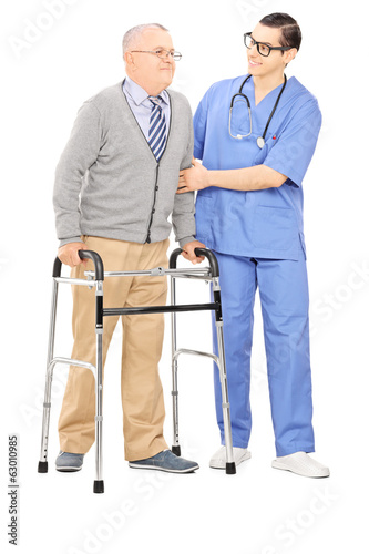 Male nurse helping a senior man with walker