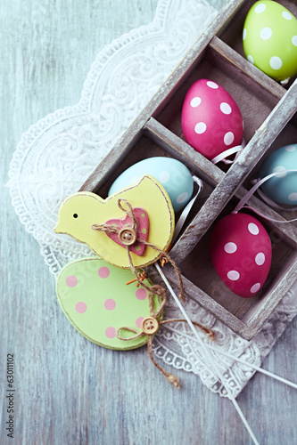Colorful Easter Eggs in a Wooden Box