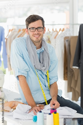 Young male fashion designer at work