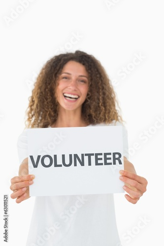 Smiling volunteer showing a poster
