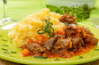 Wild boar with polenta, selective focus, close-up
