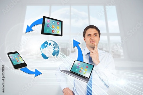 Confused businessman with computer connection graphic