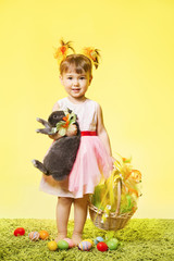 Easter little girl, kid holding bunny rabbit basket eggs