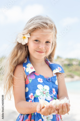 Young beautiful girl standing on beach