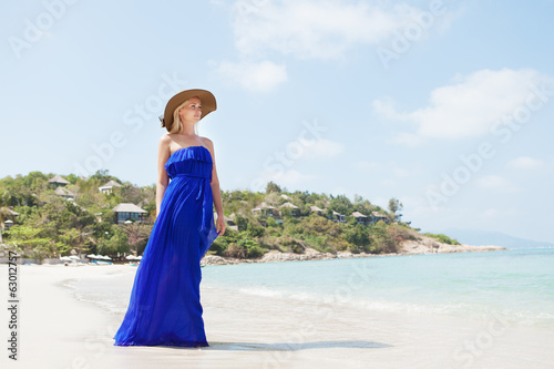 Young beautiful blonde woman on beach