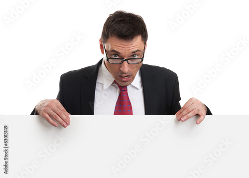 surprised business man showing blank empty white billboard sign