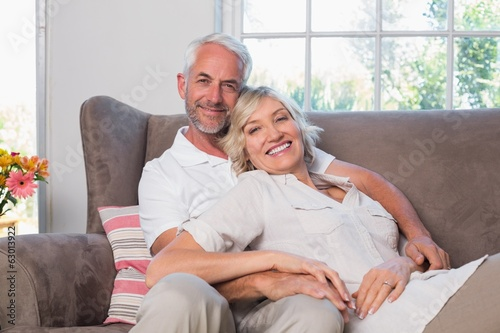 Portrait of a relaxed mature couple sitting on couch