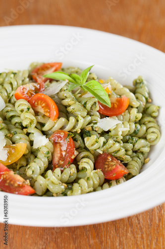 Fusilli with pesto, cherry tomatoes and parmesan