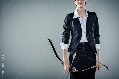Business woman suggesting while holding a bow and arrow