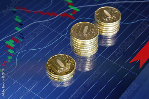 coins on background stock charts