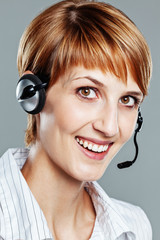 Female operator with headset smiling