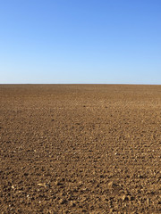 blue sky and brown soil background