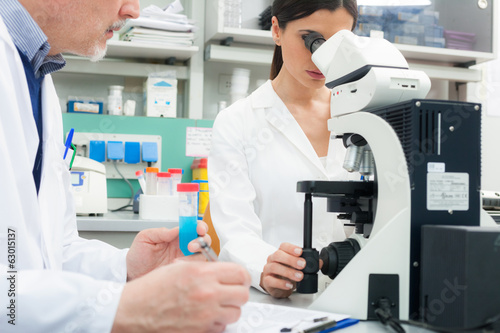 Woman using a microscope in a laboratory