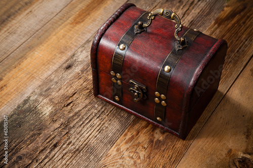 Old chest on wooden table