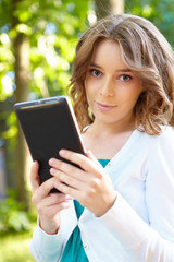 Young woman uses tablet pc.