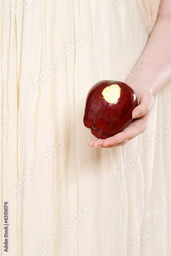 closeup woman holding red apple